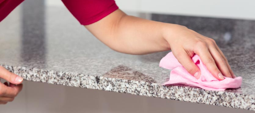 Wipe your granite countertops with a dry, clean, non-abrasive cloth.